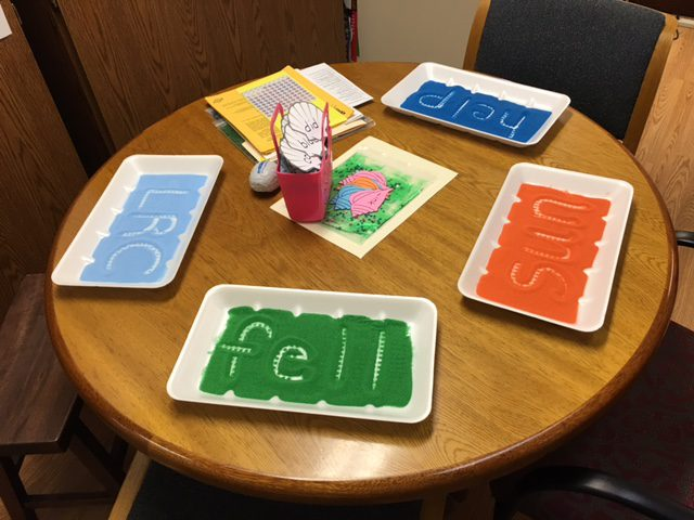 Meat trays filled with colored sand offer many multi-sensory activities to teach skills, concepts, and vocabulary.